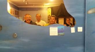 A relieved team after successful demounting of fossil plesiosaur from Bridport Museum